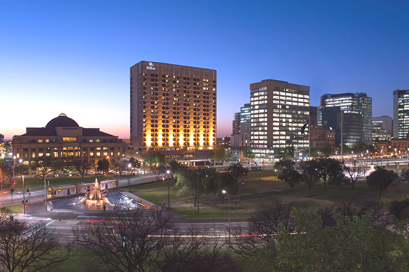 Hilton Adelaide shining in the middle of the city at night (Supplied)